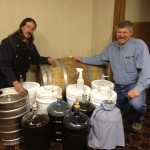 Jerry and Jon standing guard over 120 gallons of homebrew!